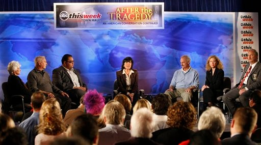 """In this photo released by ABC-TV, ABC News correspondent Christiane Amanpour, center, leads a town hall event at the St. Odilia Church in Tucson, Ariz., during a taping of """"This Week"""" with Chistiane Amanpour on Saturday, Jan. 15, 2011.  (AP Photo)"""