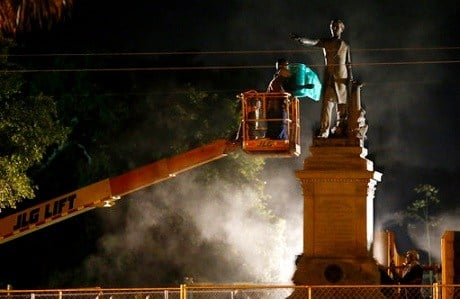 Workers prepare to take down the Jefferson Davis statue in New Orleans.