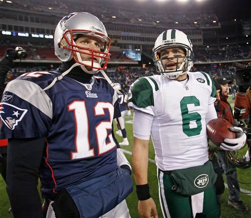 New England Patriots quarterback Tom Brady (12) and New York Jets quarterback Mark Sanchez (6) leave the field after the Jets beat the Patriots 28-21 in an NFL divisional playoff football game in Foxborough, Mass., Sunday, Jan. 16, 2011. (AP Photo)