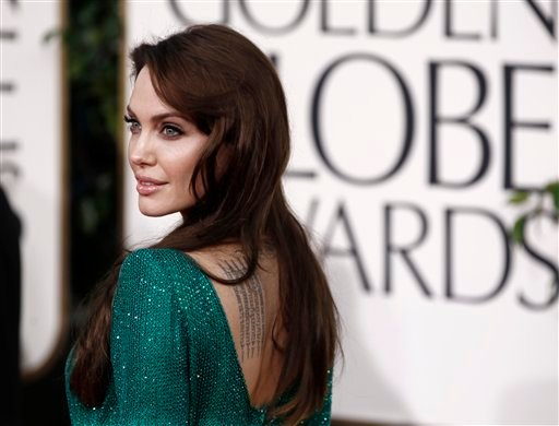 Angelina Jolie poses on the red carpet before the Golden Globe Awards Sunday, Jan. 16, 2011, in Beverly Hills, Calif. (AP Photo/Matt Sayles)
