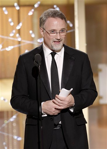 "In this publicity image released by NBC, David Fincher accepts the award for Best Director in a Motion Picture for ""The Social Network"" during the Golden Globe Awards, Sunday, Jan. 16, 2011 in Beverly Hills, Calif. (AP Photo/NBC, Paul Drinkwater)"