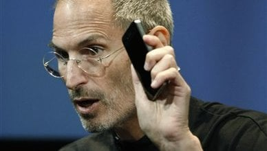 In a July 16, 2010 file photo, Apple CEO Steve Jobs holds up iPhone 4 as he talks about the Apple iPhone 4 at Apple headquarters in Cupertino, Calif. (AP Photo/Paul Sakuma, File)