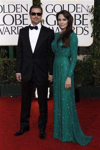 Angelina Jolie and Brad Pitt, left, arrive for the Golden Globe Awards Sunday, Jan. 16, 2011, in Beverly Hills, Calif. (AP Photo/Matt Sayles)