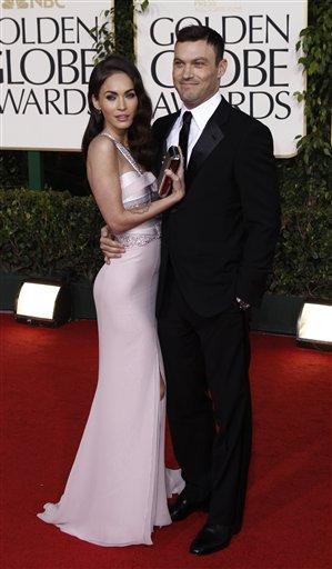 Actors Megan Fox and Brian Austin Green arrives at the Golden Globe Awards Sunday, Jan. 16, 2011, in Beverly Hills, Calif. (AP Photo/Matt Sayles)