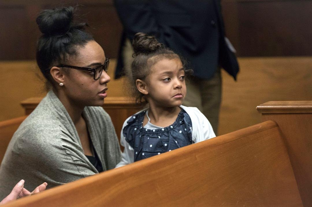 Shayanna Jenkins Hernandez, fiancee of former New England Patriots tight end Aaron Hernandez, sits in the courtroom with the couple's daughter during jury deliberations in Hernandez's double-murder trial (Keith Bedford/The Boston Globe via AP)