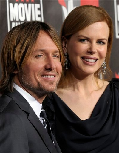 FILE - In this Jan. 14, 2011 file photo, Nicole Kidman, right, and Keith Urban arrive at the 16th Annual Critics' Choice Movie Awards in Los Angeles. The couple on Monday, Jan. 17 announced the arrival of their second daughter, Faith Margaret Kidman Urban