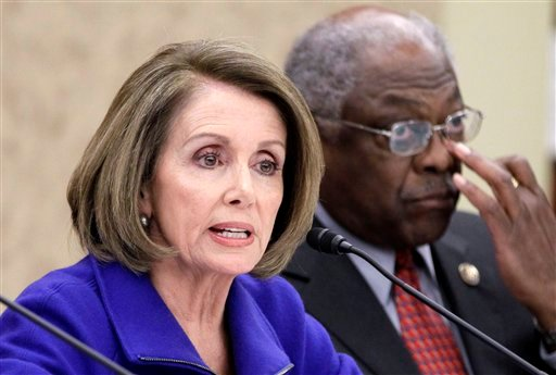 House Minority Leader Nancy Pelosi of Calif., left, accompanied by House Assistant Minority Leader James Clyburn of S.C., takes part in a Democratic Leadership Meeting on repeal of the health care law,Tuesday, Jan. 18, 2011, on Capitol Hill in Washington.