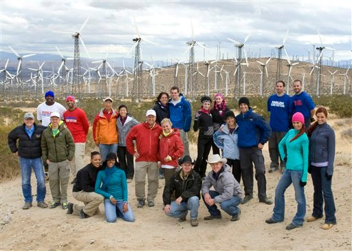 "In this undated publicity image released by CBS, 11 teams who competed in previous editions of ""The Amazing Race,"" are shown at a wind farm in Palm Springs, Calif. The teams are returning for the latest edition of the reality competition series."