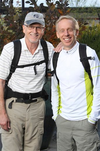 "In this publicity image released by CBS, father and son Mel White, left, and Mike White are shown in Los Angeles. The pair will compete in the latest edition of ""The Amazing Race: Unfinished Business,"" premiering Sunday, Feb. 20, 2011 on CBS."
