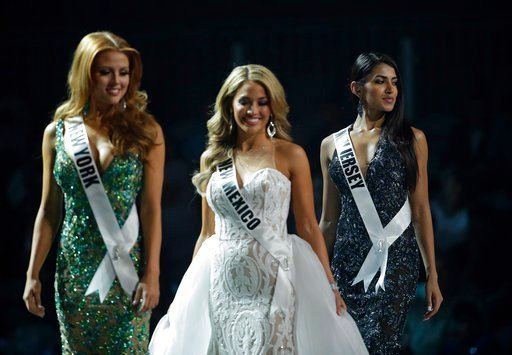 Five of the contestants vying for the Miss USA title this year were born in other countries and now U.S. citizens. (AP Photo/John Locher)
