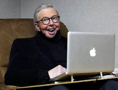 In this photo taken Wednesday, Jan. 12, 2011, Film critic Roger Ebert works in his office at the WTTW-TV studios in Chicago. Ebert, will return to his famed show 'Roger Ebert Presents At the Movies.'