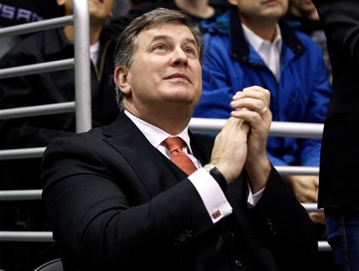 Tim Leiweke, president and CEO of AEG, the company that owns the Los Angeles Kings, claps after the Kings scored against the Chicago Blackhawks during the third period of an NHL hockey game in Los Angeles.