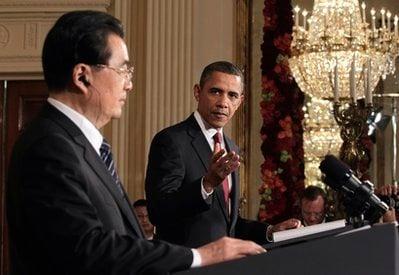 President Barack Obama gestures during his joint news conference with China's President Hu Jintao, Wednesday, Jan. 19, 2011, in the East Room of the White House in Washington.