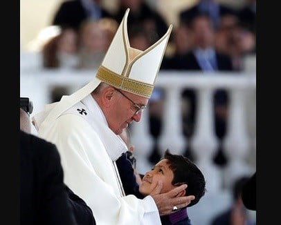 Pope Francis hugs Lucas Baptista during a mass at the Sanctuary of Our Lady of Fatima Saturday, May 13, 2017, in Fatima, Portugal.