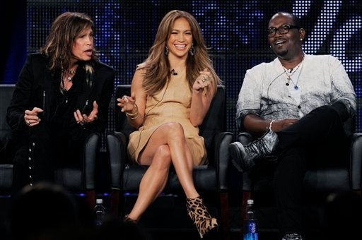 """Steven Tyler, left, Jennifer Lopez, center, and Randy Jackson, judges on the FOX show """"American Idol,"""" take part in a panel discussion during the FOX Broadcasting Company Television Critics Association winter press tour in Pasadena, Calif., Tuesday."""
