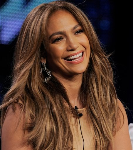 """Jennifer Lopez, a new judge on """"American Idol,"""" smiles during a panel discussion on the show at the FOX Broadcasting Company Television Critics Association winter press tour in Pasadena, Calif., Tuesday, Jan. 11, 2011. (AP Photo/Chris Pizzello)"""