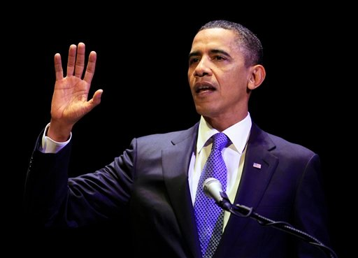 President Barack Obama gestures while speaking on the 50th Anniversary of John F. Kennedy's inauguration address, Thursday, Jan. 20, 2011, at the Kennedy Center in Washington.