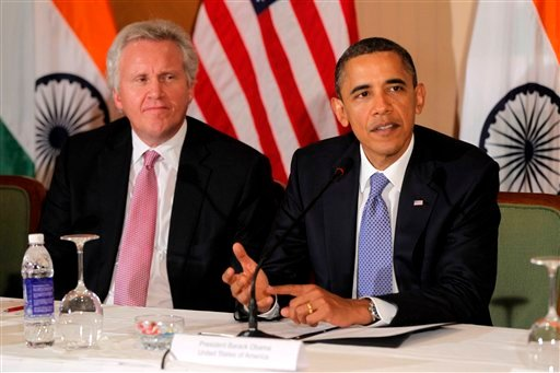 In this Nov. 6, 2010 file photo, General Electric's Jeffrey Immelt, looks on as President Barack Obama speaks at a roundtable discussion with business leaders in Mumbai, India. (AP Photo/Charles Dharapak, File)