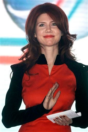 , Anna Chapman, who was deported from the U.S. on charges of espionage, is seen on stage during an event with leaders of the Young Guards. (AP Photo/Mikhail Metzel, File)