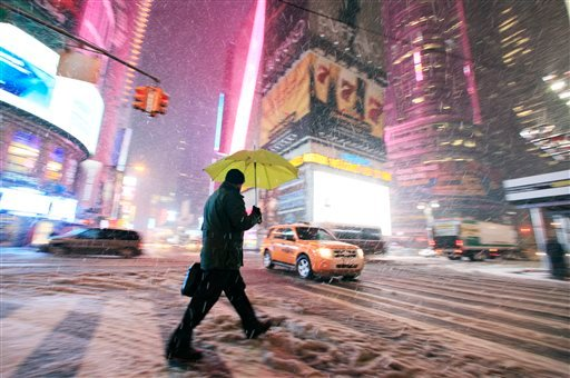A pedestrian makes his way through Times Square, Friday, Jan. 21, 2011 in New York. (AP Photo/Mark Lennihan)
