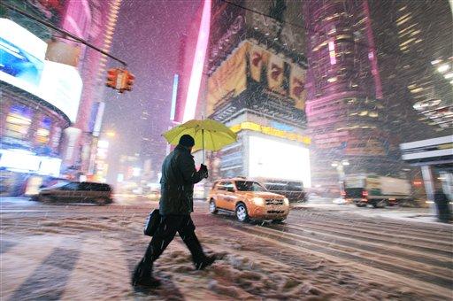 A pedestrian makes his way through Times Square, Friday, Jan. 21, 2011 in New York. (AP Photo/Mark Lennihan)