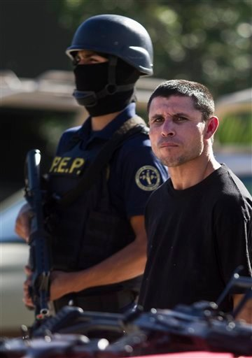 "A suspected member of the Sinaloa drug cartel, Juan Miguel Valle Beltran, right, aka ""el Boxer"" is presented to the media in Tijuana, Mexico, Thursday Jan. 20, 2011."