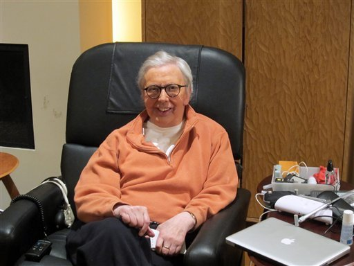 This January, 2011, photo provided by Roger Ebert shows the famous film critic wearing a silicone prosthesis over his lower face and neck.