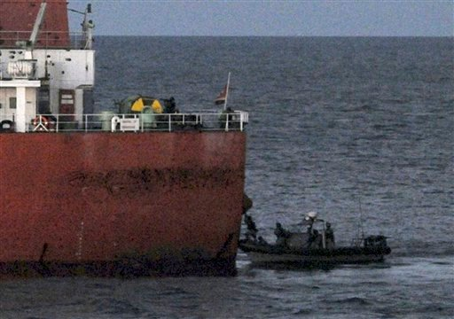 In this photo released by the Arabian Navy via Yonhap, South Korean naval special forces approach and board the South Korean cargo ship Samho Jewelry in a military operation in the Arabian Sea Friday, Jan. 21, 2011. (AP)