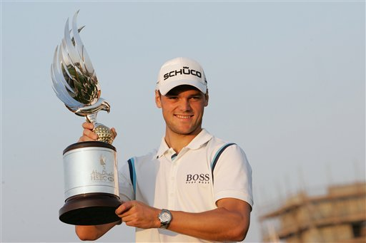 Germany's Martin Kaymer holds the trophy after he won the Abu Dhabi Golf Championships in Abu Dhabi, United Arab Emirates, Sunday, Jan. 23, 2011. (AP Photo/Nousha Salimi)