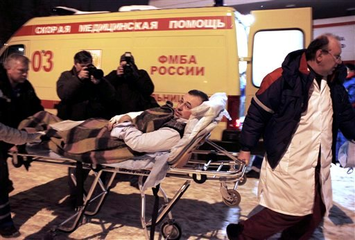 A wounded blast victim is brought by rescuers to a hospital from Domodedovo airport in Moscow, Monday, Jan. 24, 2011.