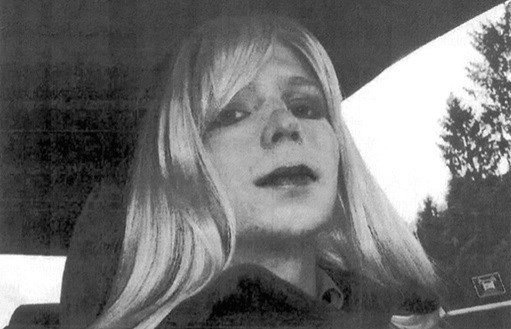 U.S. Army, Pfc. Chelsea Manning poses for a photo wearing a wig and lipstick.