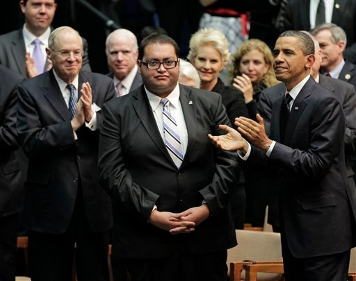 Jan. 12, 2011 file photo: Daniel Hernandez Jr., center, who was with Rep. Gabrielle Giffords when she was shot, receives a standing ovation, during President Obama's visit to speak in Tucson, Ariz. (AP Photo/J. Scott Applewhite, File)