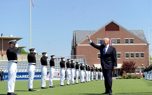 President Donald Trump waves as he arrives to give the commencement address at the U.S. Coast Guard Academy.