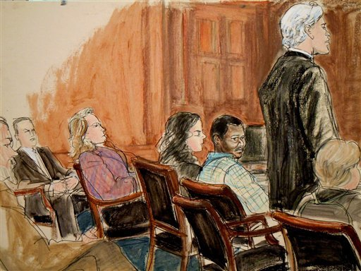 In this courtroom drawing, lead defense attorney Peter Quijano, second right, addresses U.S. District Judge Lewis A. Kaplan, while his client Ahmed Khalfan Ghailani, third right, listens as Ghailani is sentenced to life in prison Tuesday, Jan. 25, 2011.