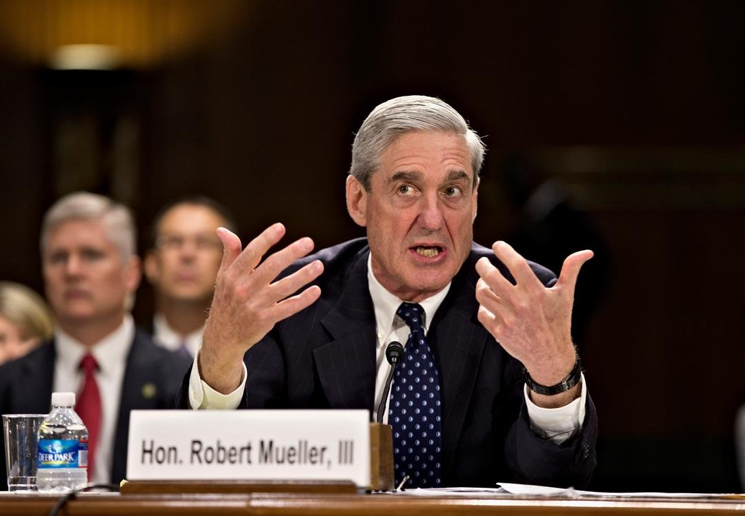 In this June 19, 2013, file photo, former FBI Director Robert Mueller testifies on Capitol Hill in Washington. (AP Photo/J. Scott Applewhite, File)
