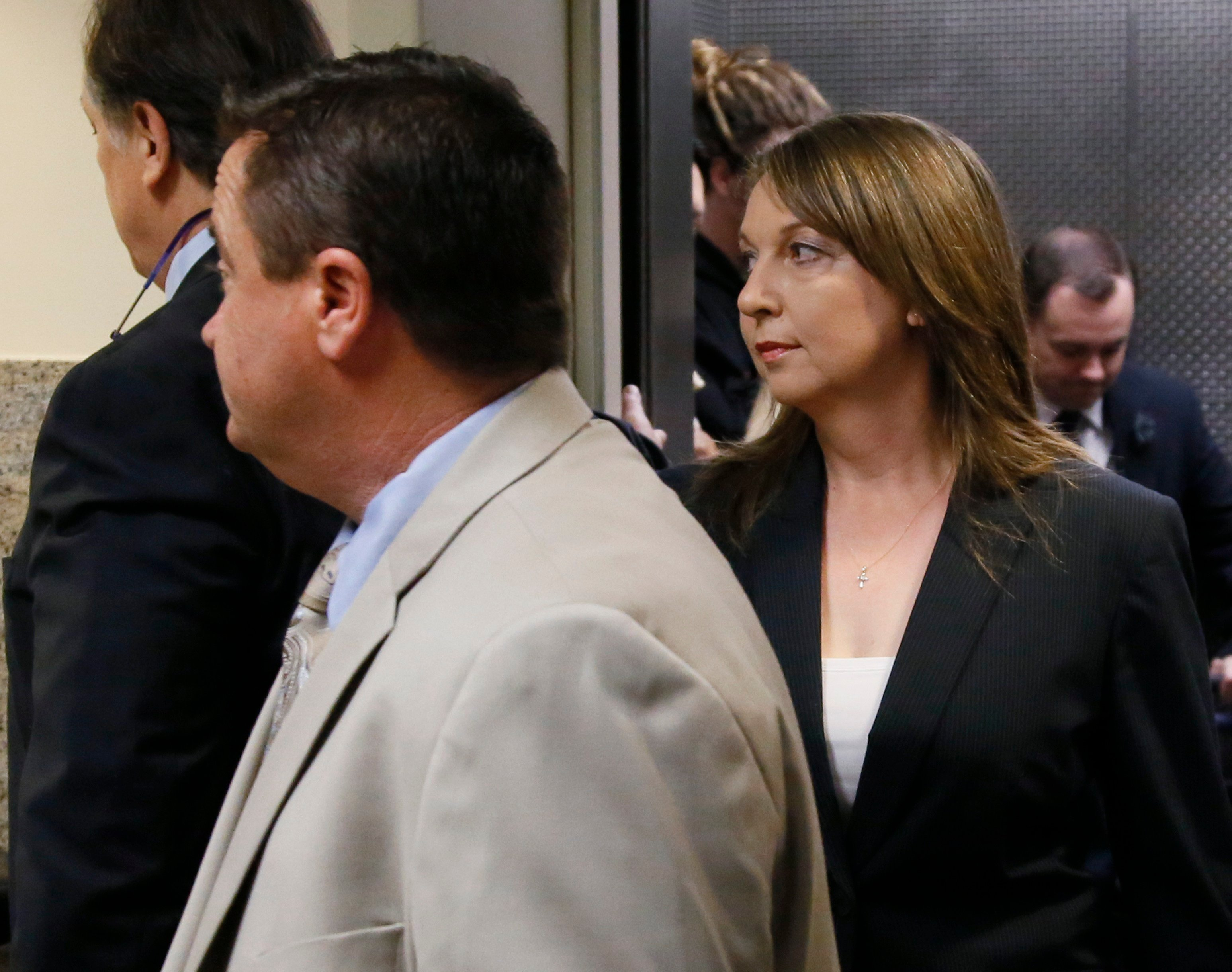 Tulsa police officer Betty Jo Shelby, right, arrives with her husband, Dave Shelby, left, for her trial in Tulsa, Okla., Friday, May 12, 2017. She is charged with manslaughter in the shooting of Terence Crutcher, an unarmed black man. (AP Photo/Sue Ogrock