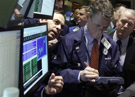 Traders work on the floor of the New York Stock Exchange Wednesday, Jan. 26, 2011. (AP Photo/Richard Drew)