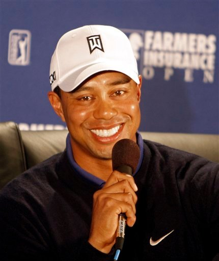 Tiger Woods answers questions during a news conference at the Farmers Insurance Open golf tournament in San Diego, Wednesday, Jan. 26, 2011. (AP Photo/Lenny Ignelzi)