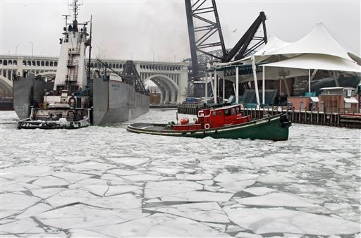 The tug California tows the 579-foot tug and barge McKee Sons down the ice-covered Cuyahoga River in Cleveland Wednesday, Jan. 26, 2011. (AP Photo/Mark Duncan)