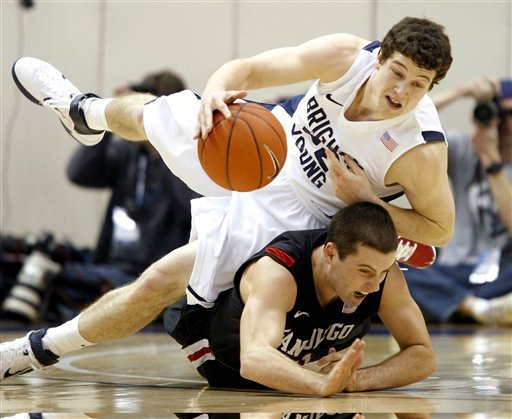 San Diego State's James Rahon, right, fouls BYU's Jimmer Fredette during an NCAA college basketball game in Provo, Utah, Wednesday, Jan. 26, 2011. (AP Photo/George Frey)