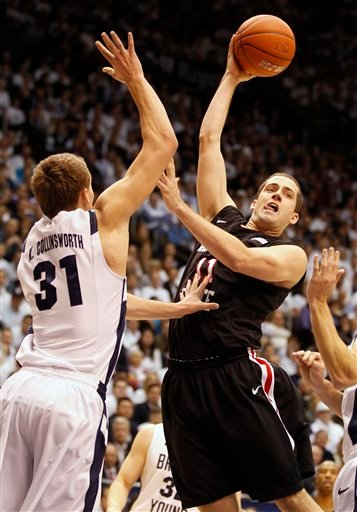 San Diego State's James Rohon, right, passes the ball as BYU's Kyle Collinsworth defends.