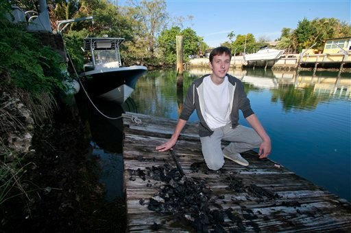 Nicholas Harrington poses on a dock in his back yard, Jan. 27, 2011 in Miami. Harrington took a bow Thursday for being the one behind the grand piano that mysteriously showed up on a sandbar in Miami's Biscayne Bay. (AP Photo/Wilfredo Lee)
