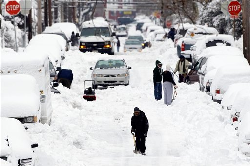 A young person makes his way down a snow-covered street in the aftermath of a winter storm in Philadelphia, Thursday, Jan. 27, 2011. (AP Photo/Matt Rourke)