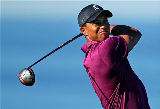 Tiger Woods watches his tee shot on the 13th hole of the North Course at Torrey Pines during the first round of the Farmers Insurance Open golf tournament in San Diego, Thursday, Jan. 27, 2011. (AP Photo/Gregory Bull)