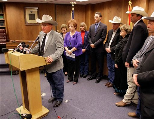 """Dr. Gary Thrasher speaks Thursday, Jan 27, 2011 at the Capitol in Phoenix after members of the Arizona Cattle Grower's Association met with legislators to discuss their 18-point """"Restore Our Border"""" plan. (AP Photo/Matt York)"""