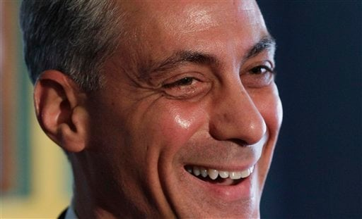 Former White House Chief of Staff Rahm Emanuel smiles after being endorsed by U.S. Rep. Mike Quigley. (AP Photo/M. Spencer Green)