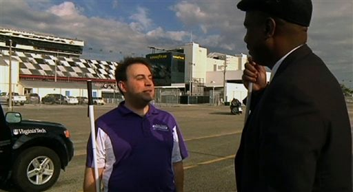 Mark Riccobono talks with Anil Lewis of the National Federation of the Blind at the Daytona Speedway Wednesday Jan. 26, 2011. Riccobono is blind and he is using nonvisual technologies to drive a car. (AP photo/Tamara Lush)
