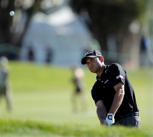 Bill Haas pitches to the sixth green of the South Course at Torrey Pines during the second round of the Farmers Insurance Open golf tournament in San Diego, Friday, Jan. 28, 2011. Haas shot 6-under par for the round, and is 11-under par for the tournament