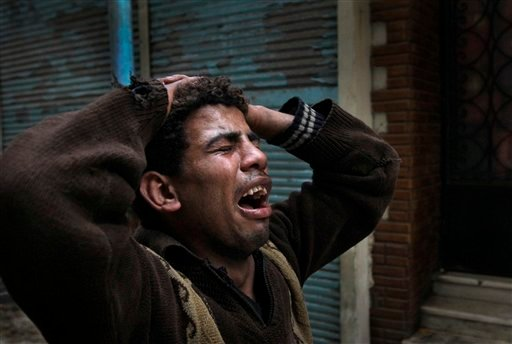 An anti-government protester cries out after seeing the body of another who was shot by police moments before, in Tahrir square in downtown Cairo, Egypt, Saturday, Jan. 29, 2011. (AP)