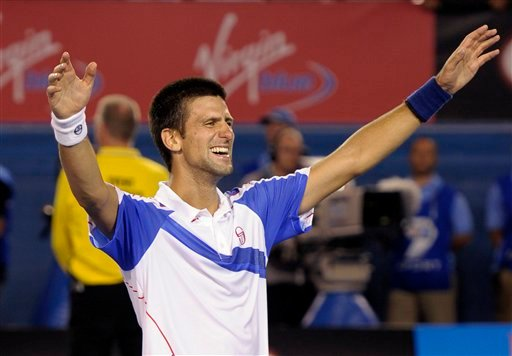 Novak Djokovic of Serbia celebrates after beating Andy Murray of Britain in men's singles final at the Australian Open tennis championships in Melbourne, Australia, Sunday, Jan. 30, 2011. (AP Photo/Rob Griffith)